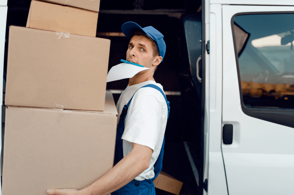 man carrying parcels out of delivery truck